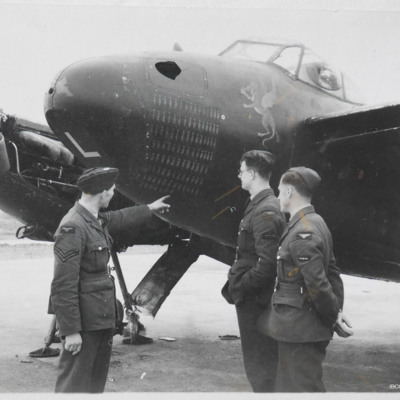 Three airmen by the nose of a Mosquito