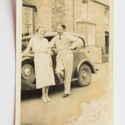 Roy and Mary Chadwick standing by a car