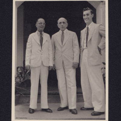 Three men standing in doorway
