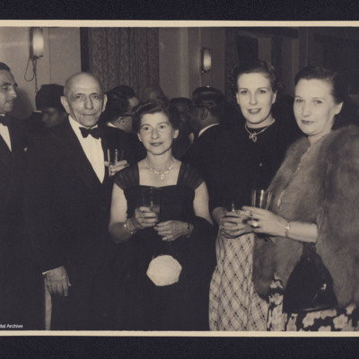 A man and three woman at a party