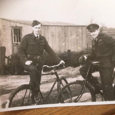 Two Airmen on their bikes