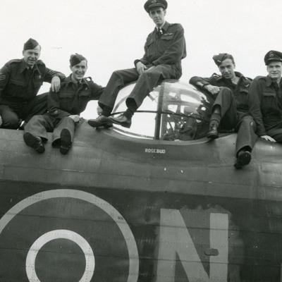 Seven airmen on a Lancaster