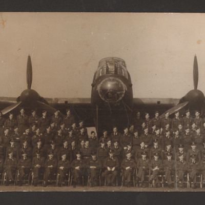 Squadron personnel in front of Lancaster