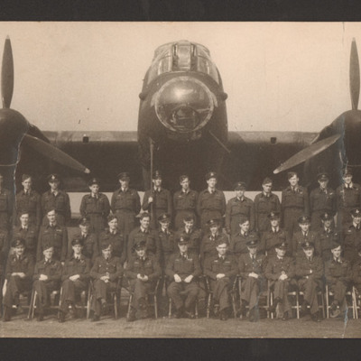 Squadron aircrew personnel in front of Lancaster