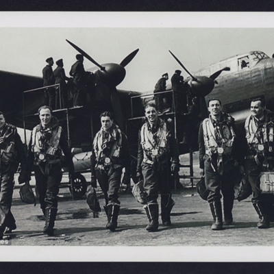Seven aircrew walking away from a Lancaster