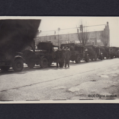 Convoy of lorries and three airmen