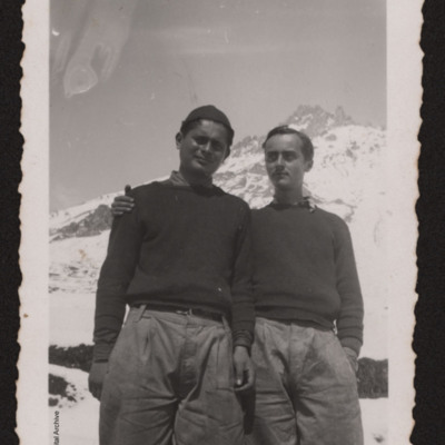 Men in front of a snow-capped peak