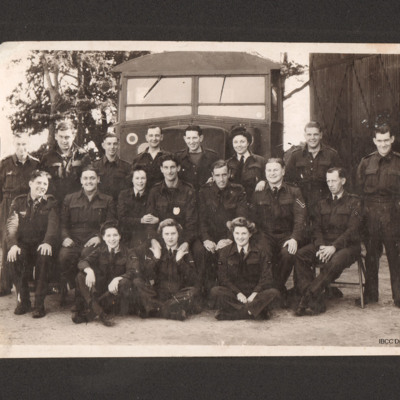 18 service personnel in front of a lorry