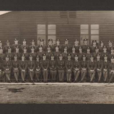 49 members of the Women's Auxiliary Air Force in front of a wooden building