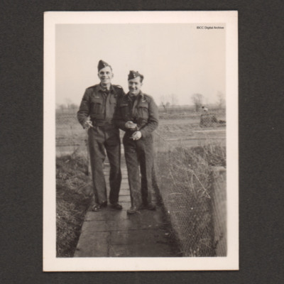 Charles Godfrey and an airman standing on a pathway