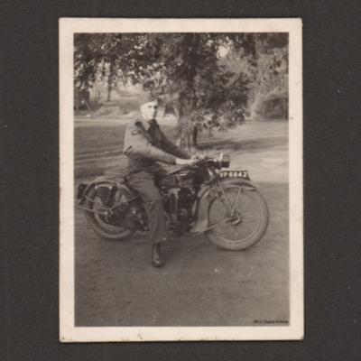 Charles Godfrey on a motorbike