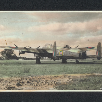 Lancaster parked on grass