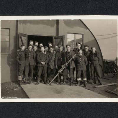 Group of armourers in front of a Nissen hut