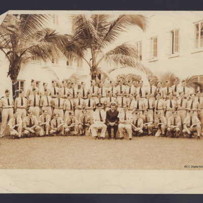 Fifty personnel in front of palm trees