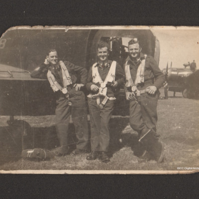 Frank Hobbs and two aircrew by the tail of a Wellington