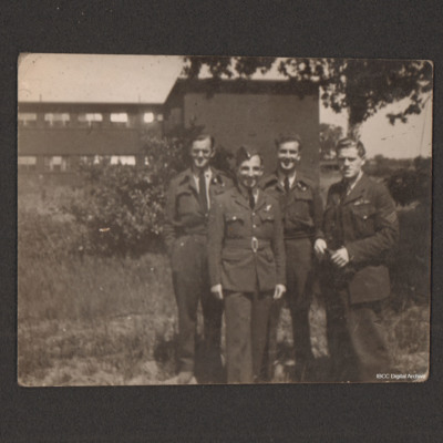 Frank Hobbs and three airmen in front of a building