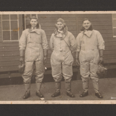 Frank Hobbs and two aircrew in front of a building