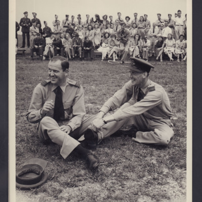 Two officers sitting on grass