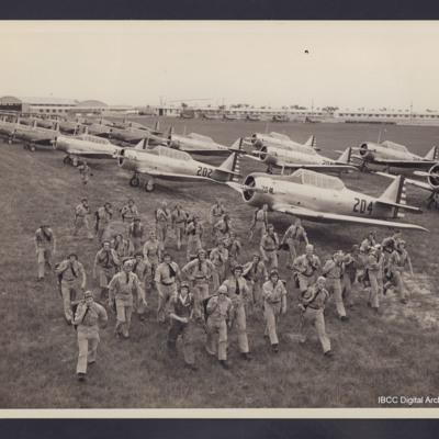 Airmen with Harvard aircraft