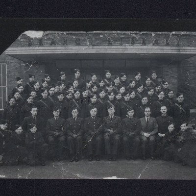 Group of ATC cadets and officers in a doorway to library