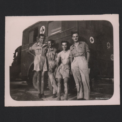 Four airmen in front of an ambulance